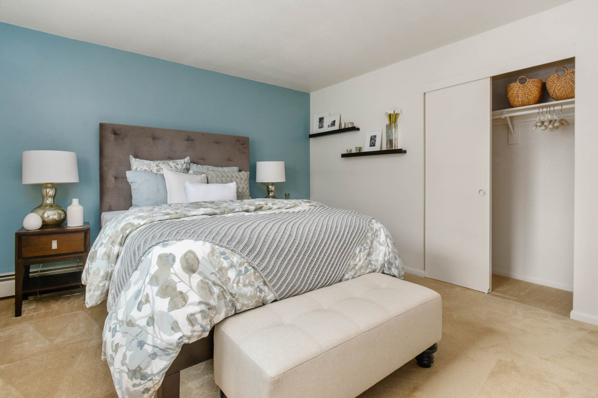 Spacious bedroom inside Saunders Crossing Apartments in Lawrence, MA