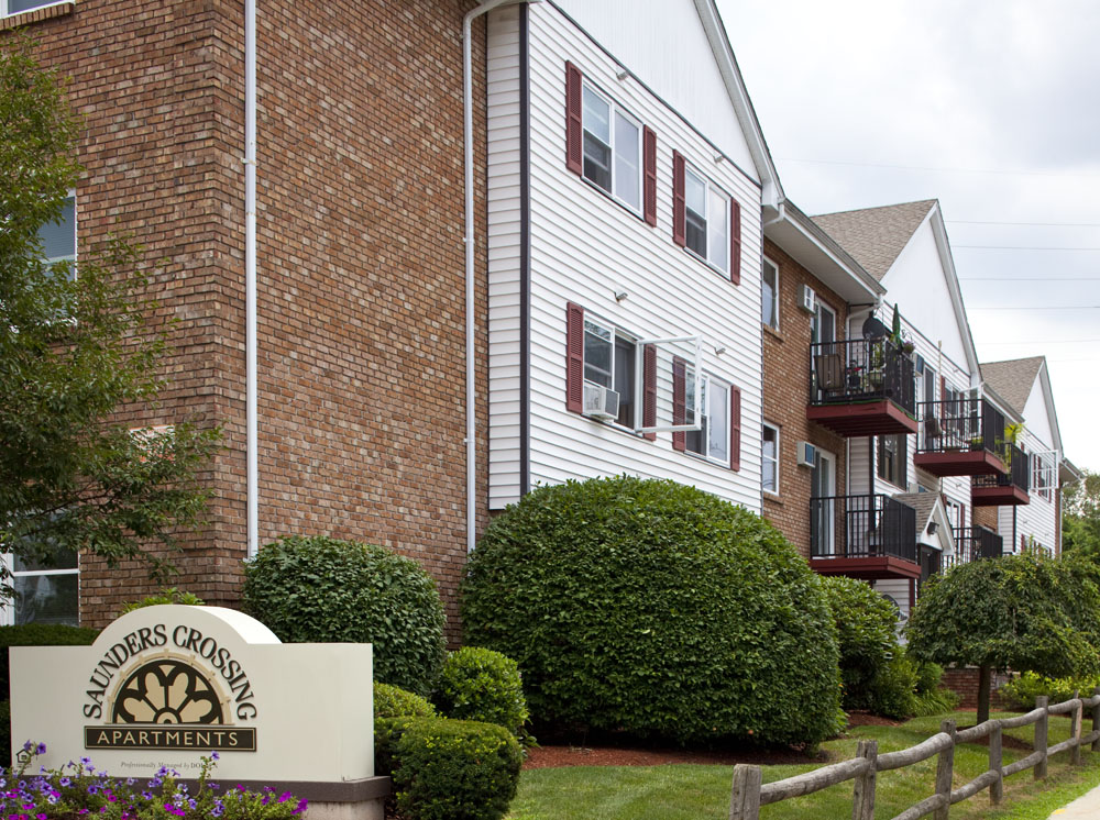 Exterior view of Saunders Crossing apartments managed by Dolben in Lawrence, MA